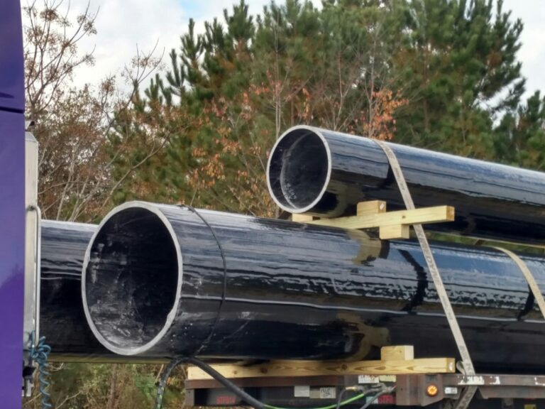 Large-diameter pipe piles ready for shipping.